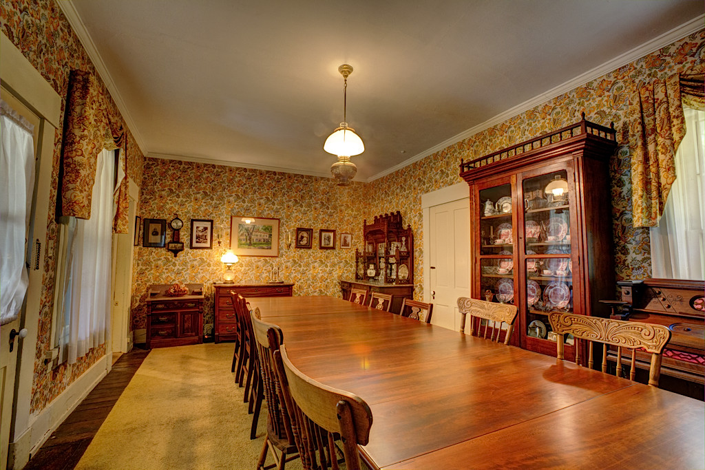 The dining room, conveniently located between the east parlor and the kitchen, can accommodate a fairly large gathering.
