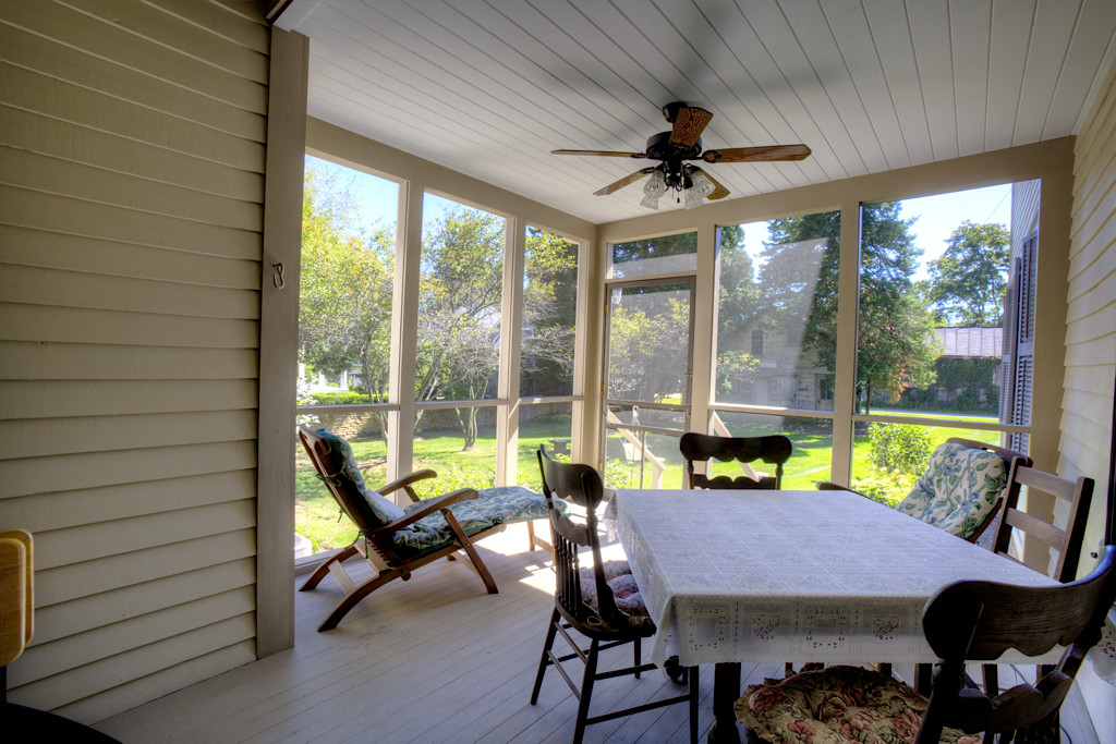 Screened porch off of dining room with door leading to back yard.