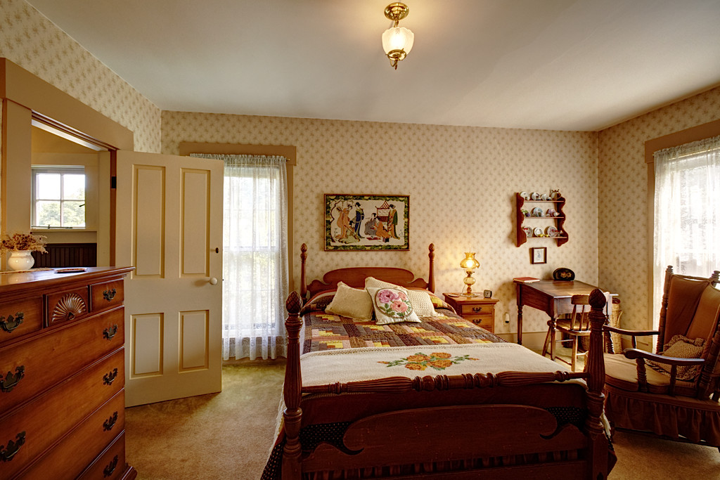 This is one of the upstairs bedrooms currently used as a guest room. This room has a full bath with claw foot tub.
